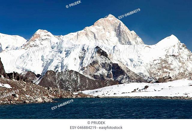 Panoramic view of Mount Makalu above lake near Kongma La pass, three passes trek, way to Everest base camp, Khumbu valley, Sagarmatha national park, Nepal