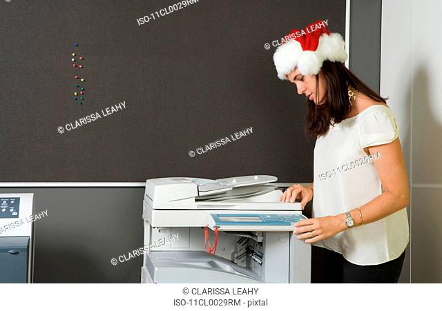 Woman making photocopy in office
