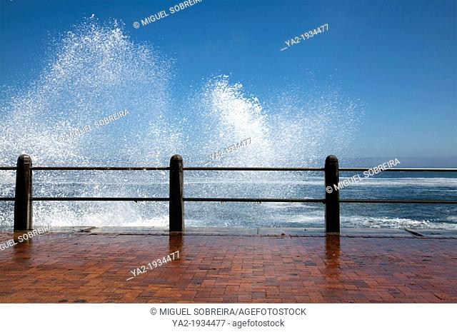 Waves crash onto Promenade Beachfront wall in Sea Point/ Mouille Point - Cape Town, South Africa