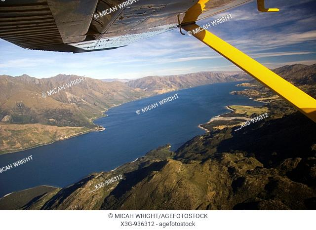 An aerial journey across the South Island into Milford Sound: Shotover River can be seen as well as various glaciers, emerald mountain top lakes