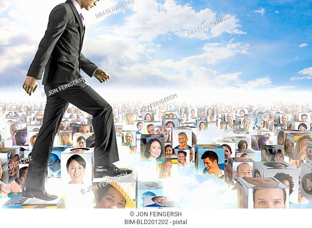 Korean businessman walking over images of business people