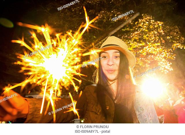 Girl playing with sparkler