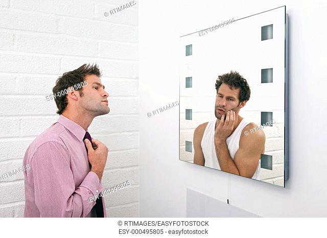 Concept image of a man getting ready in the morning with the mirror image of how he really feels