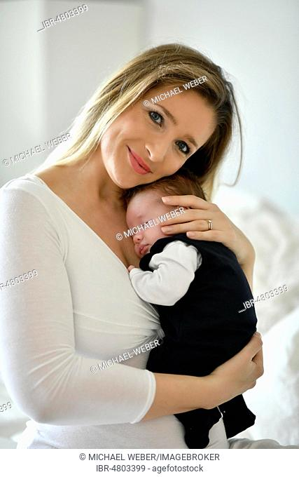 Mother holding baby, 4 weeks, Baden-Württemberg, Germany
