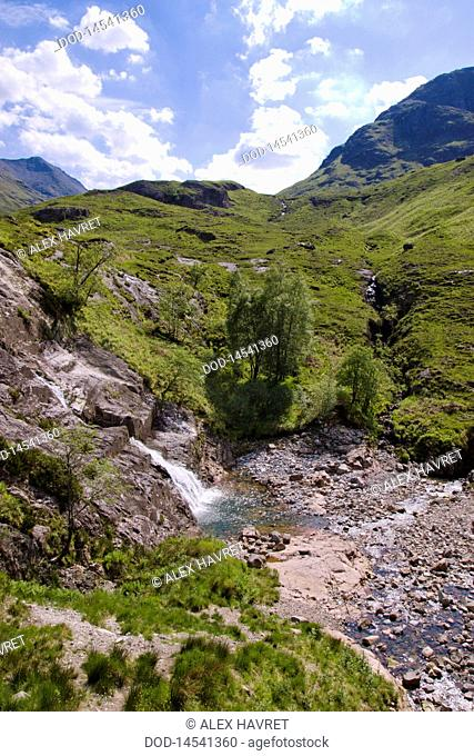 Scotland, Glencoe, Clachaig Falls in green landscape