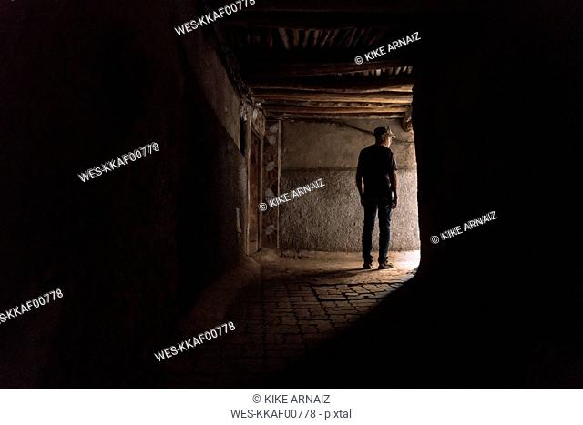 Morocco, Marrakesh, tourist standing in a passageway