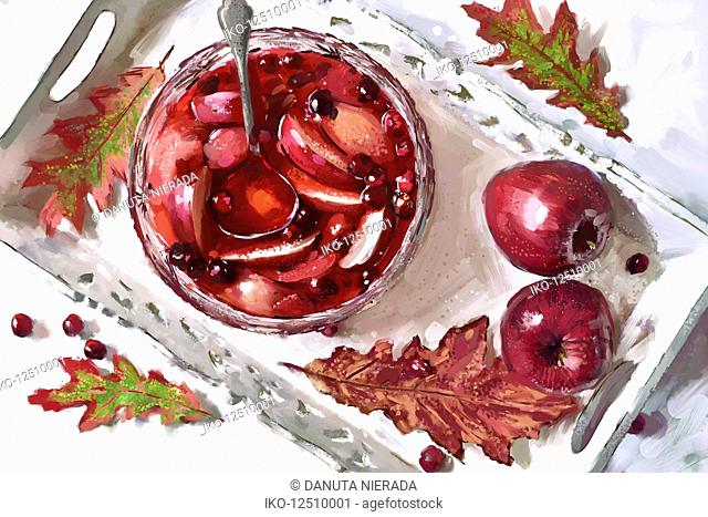 Autumn sangria cocktail in punch bowl with apples and cranberries
