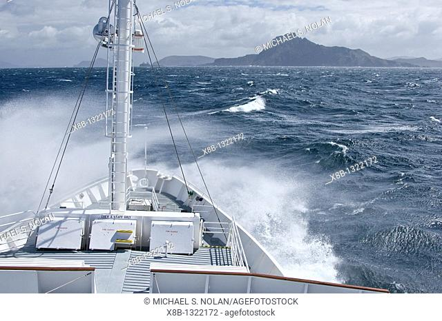 The Lindblad expedition ship National Geographic Endeavour rounding Cape Horn off the tip of Tierra del Fuego, Chile in the Drake Passage between South America...