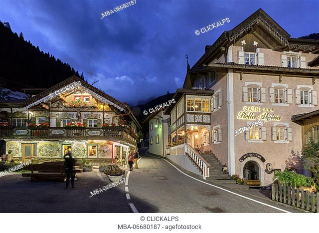 Europe, Italy, Trentino, Val di Fassa, Dolomites. Night view of the historical city center of Canazei illuminated