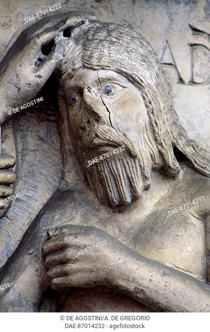 Detail from the Stories of Genesis (ca 1099), marble bas-relief of Wiligelmo (11th-12th century), facade, Modena Cathedral (UNESCO World Heritage List, 1997)