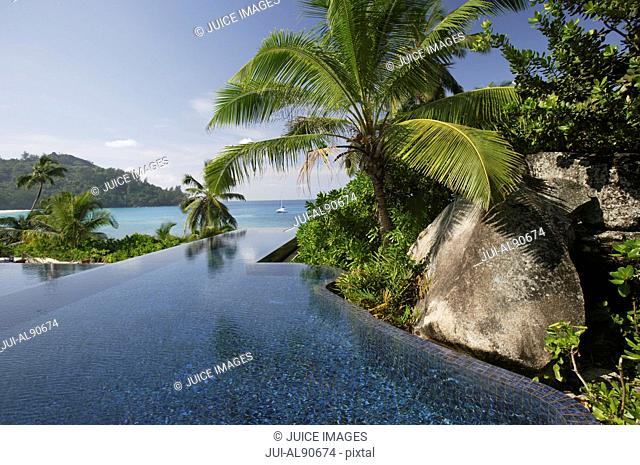 Swimming pool of the Banyan Tree Hotel with ocean in background, Anse Intendance, Mahe', Seychelles