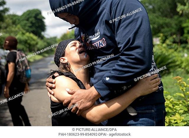 23 June 2018, Nicaragua, Managua: A woman cries after the police arrested her son. Paramilitaries stormed the National Autonomous Universities of Managua