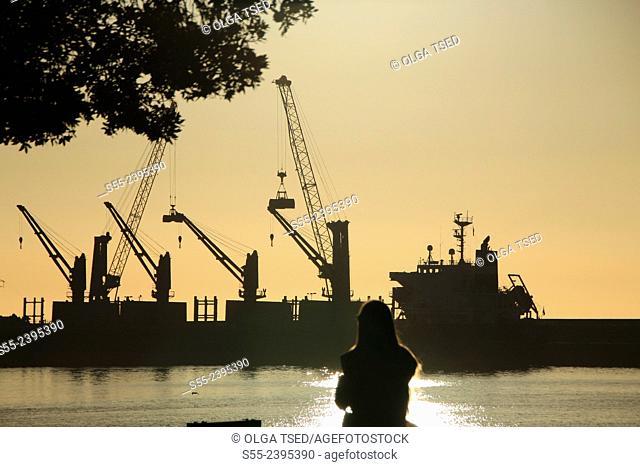 Working cranes in the seaport of Ponta Delgada in the morning. Ponta Delgada seaport, Sao Miguel island, Azores, Portugal