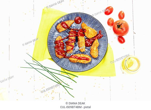Cheese croquettes on plate with tomato sauce , still life, overhead view