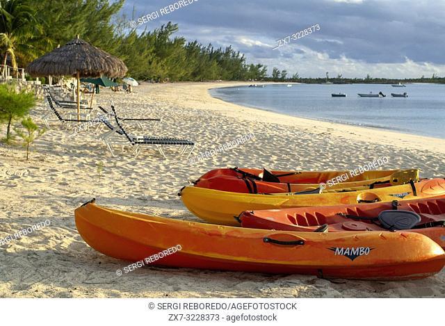 Kayaks and canoes. Beach of Fernandez Bay Village Hotel, Cat Island. Bahamas