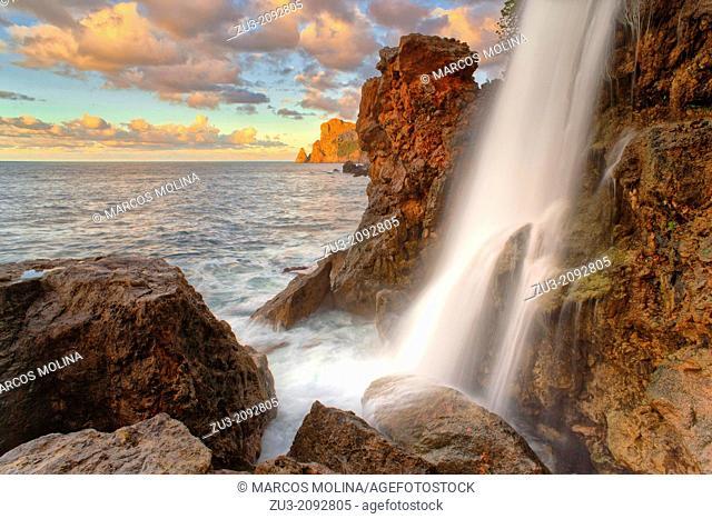 Northwest coast of Majorca. Sa Costera intermitent fresh water spring waterfall. Long exposure. Balearic islands, Spain