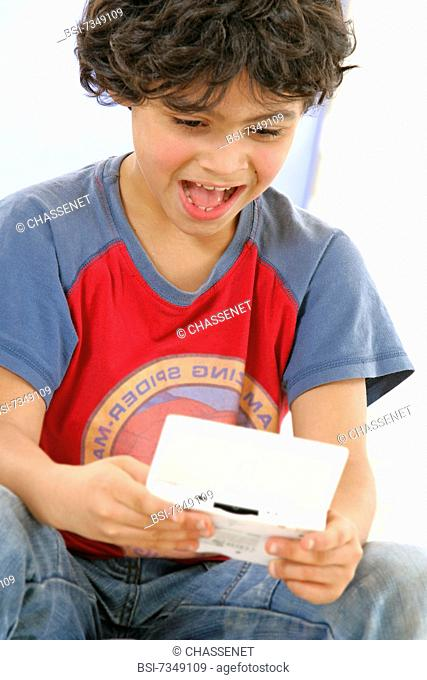CHILD PLAYING WITH VIDEO GAME