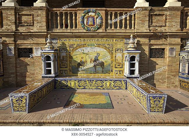 The tiled Provincial Alcoves in Plaza de España (Spain Square) in Seville, Spain