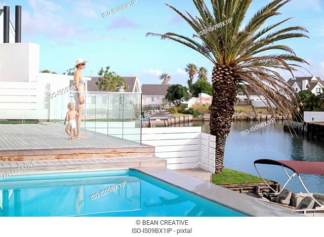 Mother and son by pool, St Francis Bay, Eastern Cape, South Africa