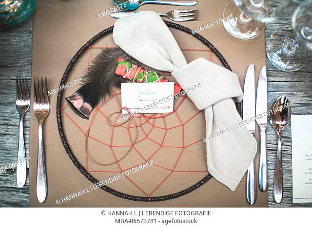 Covered table in an Indian wedding, badge