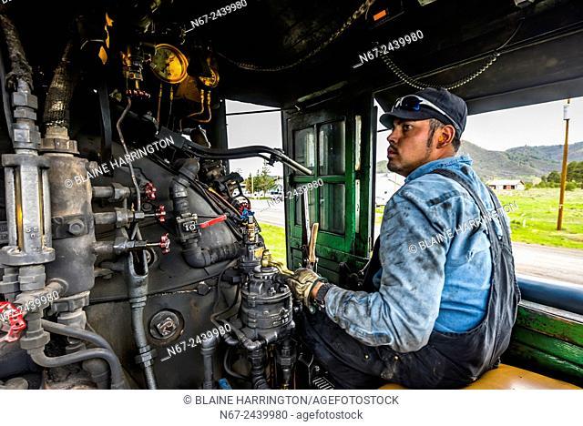 Train engineer, Cumbres & Toltec Scenic Railroad train on the 64 mile run between Antonito, Colorado and Chama, New Mexico