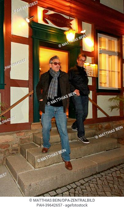 US actor George Clooney leaves a restaurant in Wernigerode, Germany, 18 May 2013. Clooney shoots scenes for his movie 'The Monuments Men' in Germany