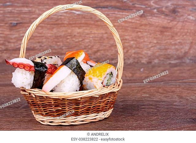 Sushi rolls set on a wooden background