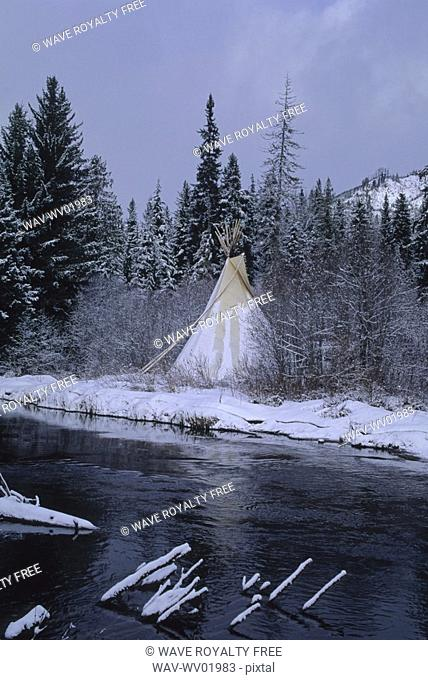 Teepee stands by small river, early winter, Whistler, BC