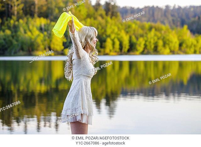 Calm lake and teen girl with Yellow scarf overhead