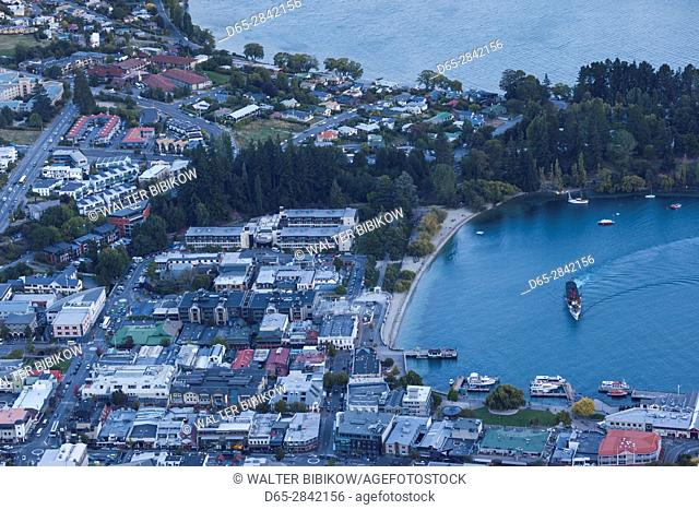New Zealand, South Island, Otago, Queenstown, elevated town view with steamer TSS Earnslaw, dusk