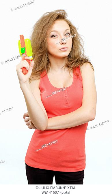 young teenage girl imitates James bond with a water pistol