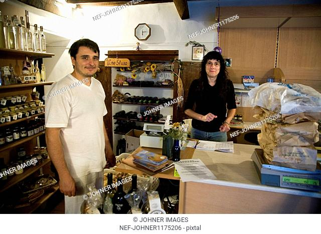 Man and woman in shop with italian food