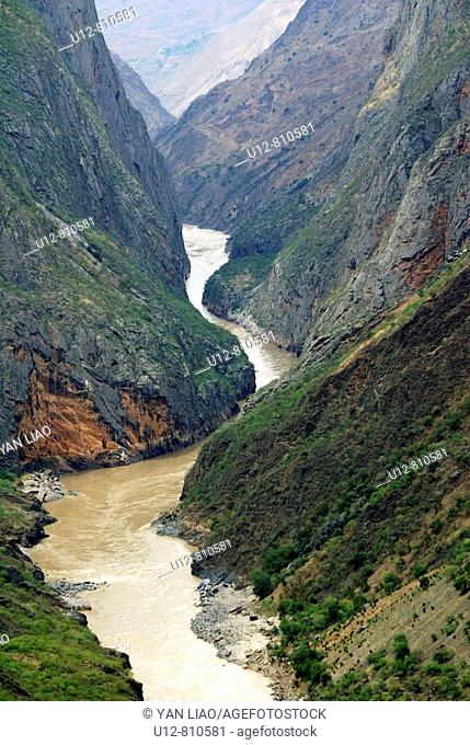 Tiger Leaping Gorge pinyin: Hutiào Xiá is a canyon on the Yangtze River - locally called the Golden Sands River, located 60 km north of Lijiang City