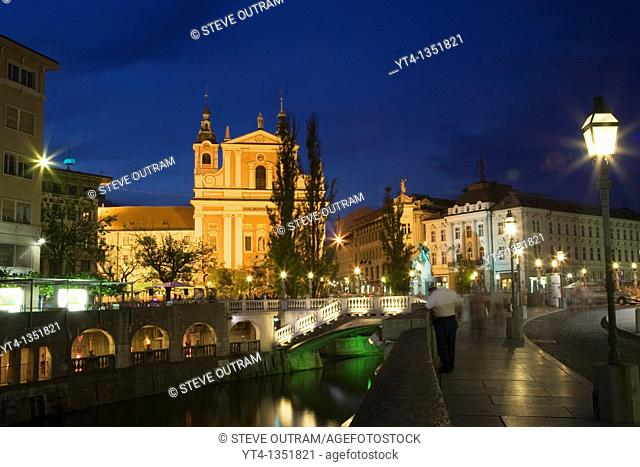 Evening view of Franciscan Church, Presernov Trg Square, Triple Bidge & Ljubljanica River, Ljubljana, Slovenia