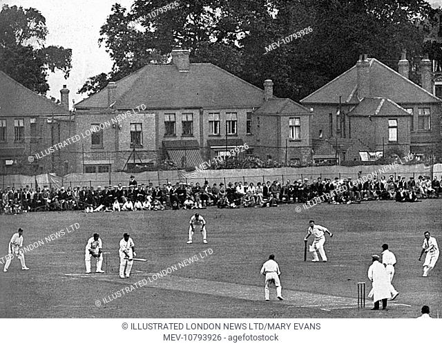 Kent host Surrey at the Rectory Field ground, Blackheath. Famous Surrey batsman Jack Hobbs is at the crease, and has been permitted to have a runner (seen at...