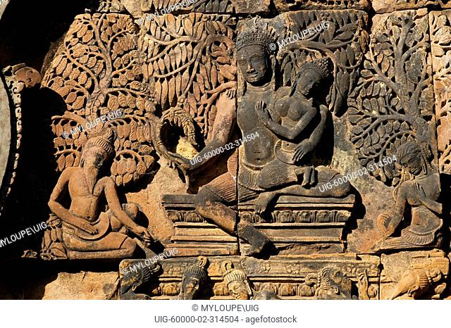 Banteay Srei with bas relief in red sandstone of the Hindu Gods Shiva & Parvati, 10th century Khmer architecture at Angkor Wat - Siem Reap, Cambodia