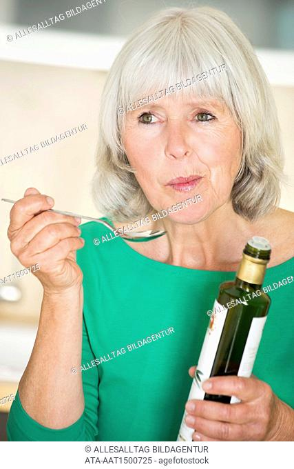 Elderly with olive oil