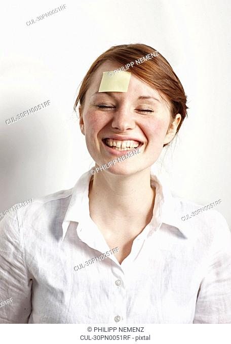 Women with Post-it on Forehead