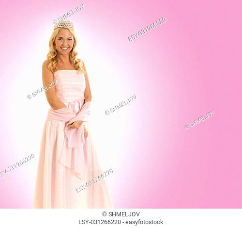 Young beautiful princess isolated on pink