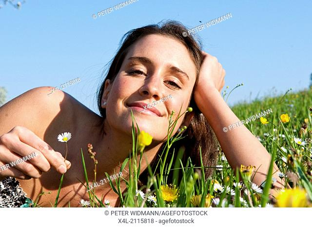 Young woman on grassland (model-released)
