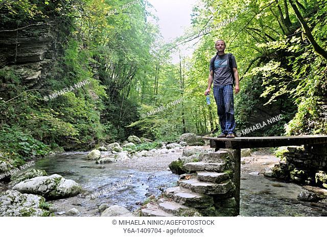 Male hiker at Kozjak brook, Kobarid, Slovenia, Triglav National Park, Julian Alps, Slovenia
