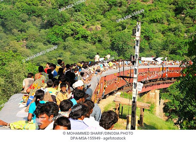 People taking risk while travelling on roof of train ; Goram ghat ; Marwar Junction ; Rajasthan ; India