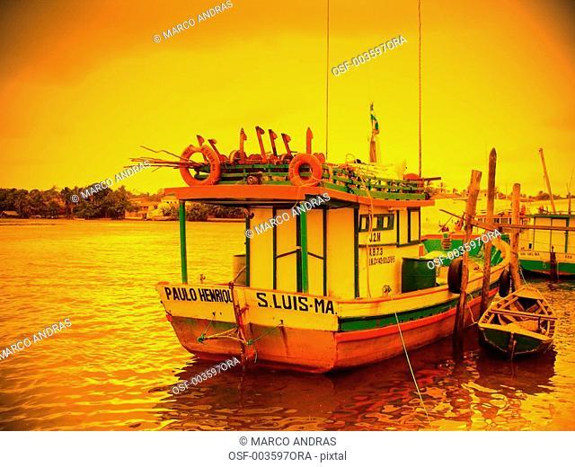 sao luis do maranhao sunset light into the anchored boat