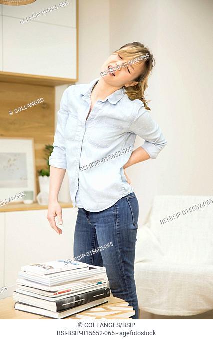 Woman suffering from lumbago