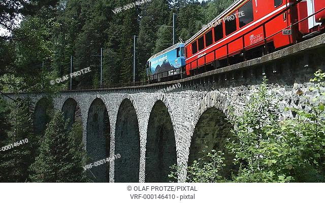 Alpine train at the Landwehr Viaduct in the Swiss Alps, Switzerland