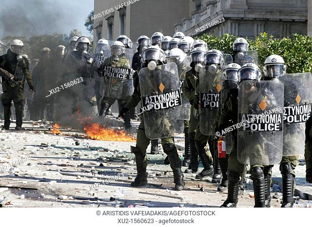 19 October 2011 Athens Greece  Protesters clash with riot police, throw fire bombs and stones against them  Thousands of Greek people protest against the new...