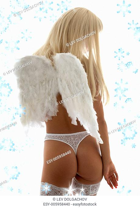 blond girl with angel wings and snowflakes