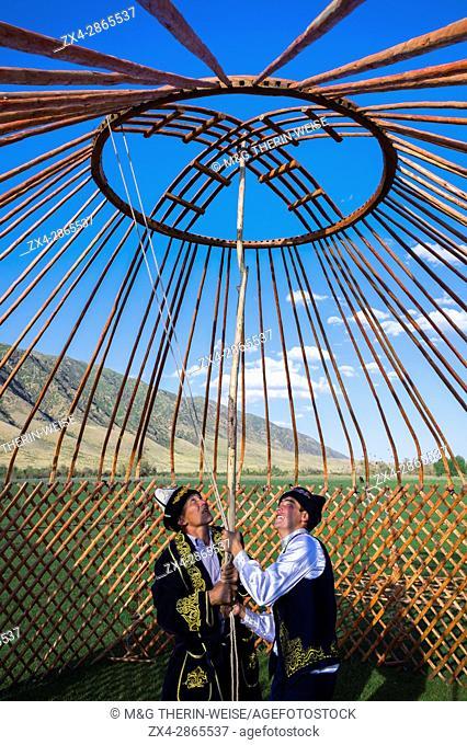 Kazakh men putting up a yurt, For editorial Use only, Sati village, Tien Shan Mountains, Kazakhstan