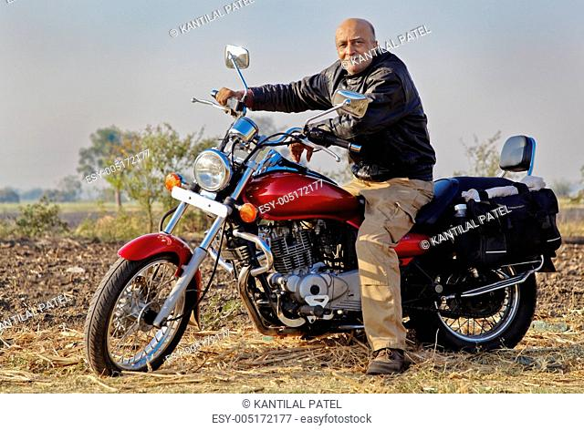 Senior Indian citizen Motor bike rider on a cruiser