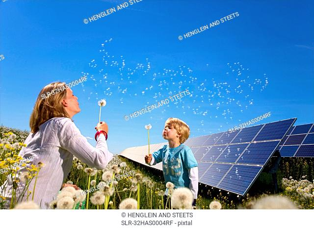 Mother and son with solar panels